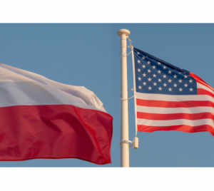 The flags of Poland and the United States flying next to each other.