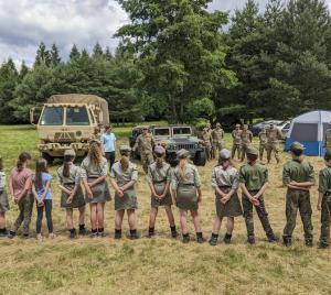 U.S. Army 1st Lt. Eduardo Santiago, detachment commander for the 266th Ordinance Company, a Reserve unit out of Puerto Rico, speaks with Polish scouts about his unit's mission in support of Atlantic Resolve at Camp Watra near Osieczow, Poland.