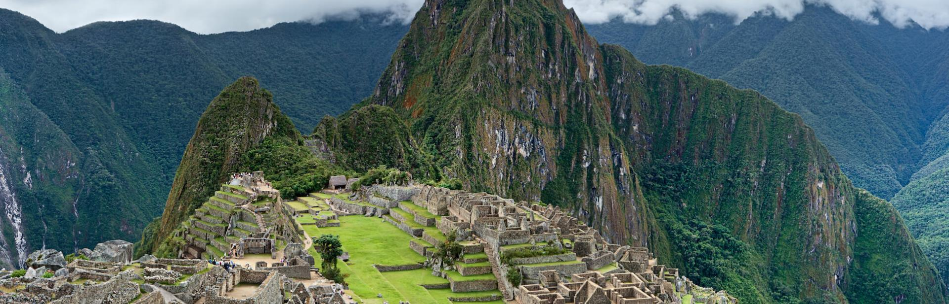 Ruins of Machu Picchu with a mountainous background.