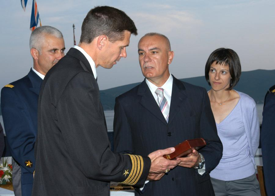 Minister of Defense Boro Vucinic and USS Emory S. Land (AS_39) Commanding Officer, Capt. Jeffrey M. Hughes, exchange gifts during a reception on board the Emory S. Land to celebrate Montenegro's first year of independence.