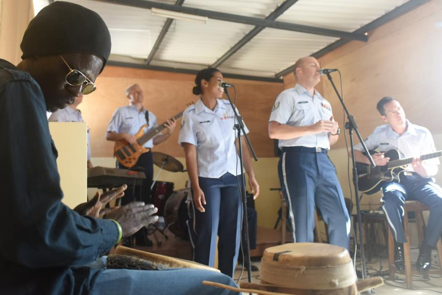 A student plays a drum along with the U.S. Air Forces in Europe Band at the National School of the Arts in Dakar, Senegal.